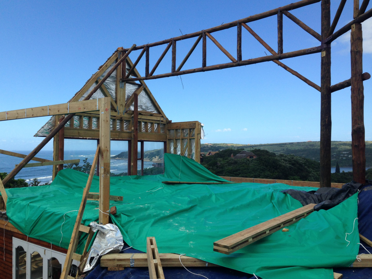 Thatch Roof being Reconstructed with new roofing