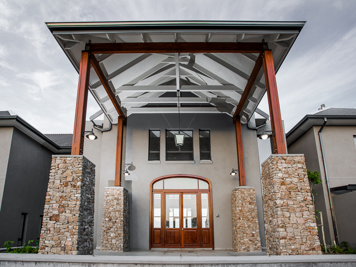 The Main Entrance - Double Story with Exposed Trusses and Custom Timber Posts