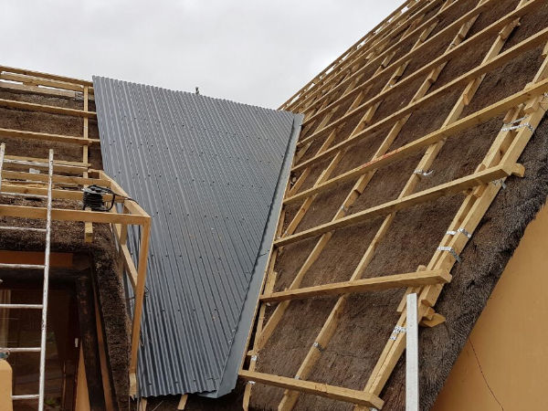 Over-sheeting a Thatch Roof